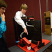 Student explains Rube Goldberg machine.