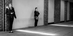 Smoking zone (phil anker) Tags: people street mono smokers negativespace fujix70