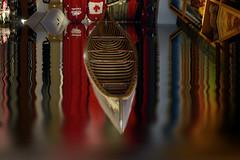 Southern Reflections (Brian 104) Tags: canoe outofplace upsidedown aberration flood