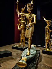 Figure of King Tutankhamun on a reed boat New Kingdom 18th Dynasty Egypt 1332-1323 BCE (mharrsch) Tags: figure figurine sculpture statue pharaoh king ruler tutankhamun burial tomb funerary 18thdynasty newkingdom egypt 14thcenturybce ancient discoveryofkingtut exhibit newyork mharrsch premierexhibits gold crown boat