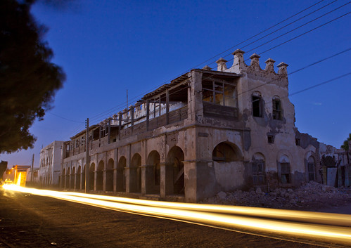 A Car Passing By A Former Ottoman Empire House By Night, Berbera, Somaliland