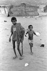 Growing in the desert (vytautas ambrazas) Tags: india boys childhood desert documentary 35mmfilm analogphotography rajasthan rurallife thardesert leicamp lifeinthedesert leicasummicronm35mmf2asph