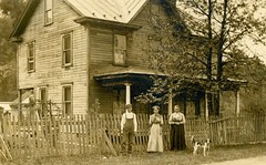 Boy, Women, and Dog in Front of a House (Alan Mays) Tags: old trees houses homes windows yards dogs boys animals portraits vintage buildings children clothing women photos antique fences ephemera clothes photographs dresses postcards overalls foundphotos porches rppc realphotopostcards