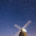 As the windmills and the heavens turn