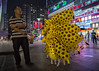 Chubby Giraffes (Michael Steverson) Tags: china street city urban man night balloons balloon chinese chinadigitaltimes vendor giraffe guangxi