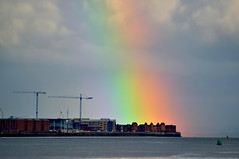 Rainbows End (Dave McGlinchey) Tags: sky water rain clouds rainbow nikon skies cloudy atmosphere atmospheric partial cloudscapes optic d5000 cloudsstormssunsetssunrises