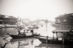 Water town (Marc Gascoigne) Tags: china travel people blackandwhite bw boat canal ancient shanghai historic canon5d traveling watertown zhujiajiao boatmen canaltown