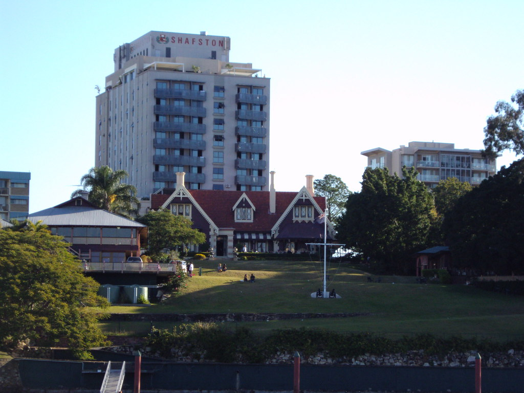 Gothic mansion and apartments along the Brisbane River near the CBD.