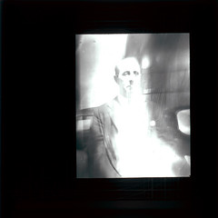 A Psychic Portrait (Tyne & Wear Archives & Museums) Tags: light abstract man reflection window person photography mirror weird scary distorted spirit room coat ghost captured shapes experiment fake surreal blurred eerie creepy clothes odd unknown opening form unusual lecture paranormal psychic seated blazer shining spiritphotography outlet fraud forces supernatural ectoplasm cleanshaven testcase blankexpression demontration blackandwhitephotograph lanternslides anewangle mrcpmaccarthy