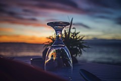 Romantic Dinner (Syahrel Azha Hashim) Tags: glass lombok nature sony indonesia dinner nopeople simple 2017 ocean dramaticsky tropicalisland island ilce7m2 dof romanticdinner dinnertable details sunset sonya7 romantic getaway handheld a7ii colorimage vacation clouds prime holidayresortlombok 35mm naturallight moment colorful oceanview beautiful travel syahrel holiday view colors outdoor shallow light tropical detail