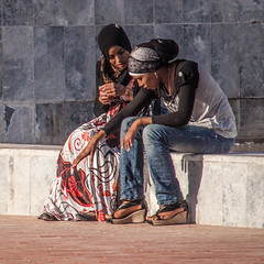 at the beach (Jan Herremans) Tags: janherremans africa morocco girls ladies women beach sunset colours wall headdress ainly certasinly