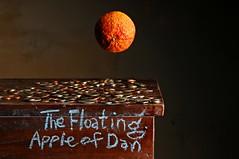 The Fraud (Studio d'Xavier) Tags: thefraud thefloatingappleofdan fraud orange levitation stilllife strobist