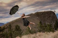 Way she goes (Lichon photography) Tags: levitation lichonphotography cloud umbrella float surreal surrealism spring okanagan okanaganphotographer grass munsun mountain landscape