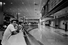 等待 Waiting (Varbow) Tags: analog asa bw camera capture 28mm 35mm contax g1 kentmere film waiting taiwan taipei airport photography picoftheday portait black