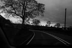 Menace (Gary Kinsman) Tags: cheshire 2017 fujix100t fujifilmx100t bw blackwhite country countryside car onthemove movement motion hills road ontheroad eastcheshire storm dark brooding clouds overcast tree menace