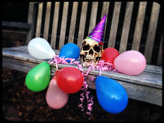 Life of the Party (Creepella Gruesome) Tags: iphone6splus hipstamatic skull partyhat balloons ribbons colors surreal creepy phantasm