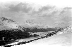 04a3371 34 (ndpa / s. lundeen, archivist) Tags: nick dewolf nickdewolf bw blackwhite photographbynickdewolf film monochrome blackandwhite april 1971 1970s 35mm europe centraleurope switzerland swiss alpine alps graubünden grisons stmoritz easternswitzerland suisse schweitz mountains peaks snow snowy snowcovered skiresort skiarea skislopes skiing landscape sky clouds valley slopes swissalps