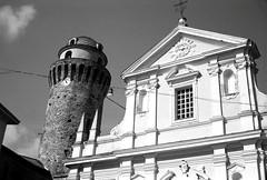 Ortonovo, Liguria (Mattia Camellini) Tags: yashicaelectro35gt vintagecamera mattiacamellini yashinon1745mm analogue analog pellicola rangefinder rolleisuperpan200 kodakd76 manualfocus chiesa church architecture liguria ortonovo 35mm