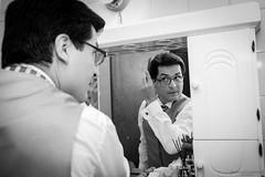 Finishing touches (Mariano Colombotto) Tags: wedding boda casamento casamiento portrait retrato byn bnw blackandwhite blancoynegro tucuman argentina previa groom novio nikon mirror espejo