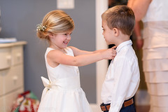 Flowergirl helping the ring bearer with his tie (Ryan Smith Photography) Tags: wedding weddingphotography myrtlebeach httpswwwryansmithphotographycom