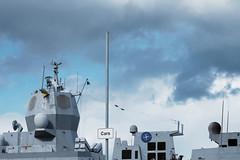 Cars. Also warships. (Bob_Last_2013) Tags: warship navy signage skyscape grey