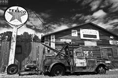 Sold (Ian Sane) Tags: road camera light sky sun white black classic sign clouds oregon truck canon vintage lens ian