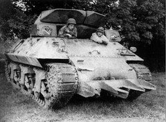 M10 Tank Destro<br />yer equipped with the T1E1 Rhinoceros hedgerow cutter, prior to Operation Cobra, in France, circa mid-July 1944