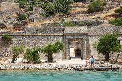 Circling Spinalonga (5) (nican45) Tags: sea tree slr rock stone architecture canon landscape fort entrance hellas greece crete gateway dslr tamron fortress spinalonga elounda kriti 600d  18270   kalydon 18270mm  eos600d 18270mmf3563diiivcpzd