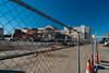 Behide the Fence (Jocey K) Tags: newzealand christchurch fence buildings lights demolition cbd diggers architecure nibbler roadcones demolitionmillersdepartmentstore demolitionformercivicbuilding