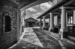 The Old Restaurant (davebugyi) Tags: wood old summer sky people blackandwhite bw building architecture outdoors mono restaurant hungary shadows exterior wine eating barrels columns perspective sunny historical winecellar villany