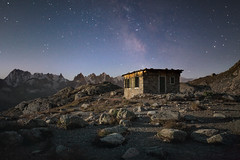 Hut in the Moonlight (a galaxy far, far away...) Tags: lacblanc aiguillesrouges montblanc argentière night nightphotography nightshot nightsky stars milkyway scorpius robertobertero canon canon5dmarkii 1740canon moonlight lucelunare clairdelune alpinehut stones mountain atmosphere atmospheric mood moody grandesjorasses outdoorphotography