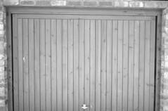Frame lines test 40mm f1.4 VC SC Delta 100 Pyrocat HD (Man with Red Eyes) Tags: door analog blackwhite garage delta100 iv ilford leicam6 homedeveloped semistand presoak 15mins silverhalide filmtest pyrocathd summicron35mmf2 frametest developertest 40mmf14voigtlandersc 1yellowfilter