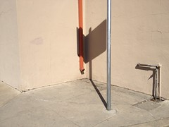 Orange (misterbigidea) Tags: abstract urban city scenic landscape concrete shadow drainpipe corner pole sign neighborhood geometry shapes orange wall building sidewalk fragment explore