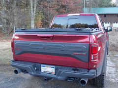A Heavy Duty Truck Bed Cover On A Ford F150 Raptor (DiamondBack Truck Covers) Tags: aluminum tonneaucover truckbedcover diamondback diamondplate pickuptruck redtruck ruggedblack ford f150 ff15 raptor c hd heavydutytruckbedcover noaccessories 0015000001ig5xiaar outdoors woods rearview closed