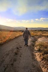 Headed Back to the Car (wyojones) Tags: wyoming cody walk hills car badlands sagebrush evening sunset twilight road