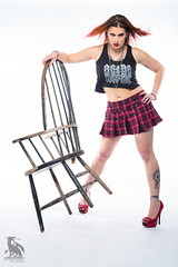 Bad Attitude (CJ Schmit) Tags: wwwcjschmitcom 5dmarkiii canon canon5dmarkiii cjschmit cjschmitphotography canonef50mmf18ii photographermilwaukee milwaukeephotographer photographerwisconsin racine racinewisconsin dragonspitstudios tiffanywoller skirt heelstshirt rocker rockerchick acdc tattoos ink rings bracelets shortskirt pladskirt halfshirt piercings redhair sexy legs redheels hot woman modelshoot studioshoot portrait portraitshoot studiolighting digibeedb800 buff51 white plmpocket wizardshigh contrast red chair caledonia wisconsin