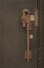 opening this door (f o t o o r a n g e) Tags: pipewrench doorhandle ossingtonavenue toronto