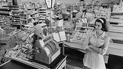 1966 Supermarket Protest - Bored Cashier (Brett Streutker) Tags: 1960s oneperson employee halflength portrait cashier cashregister threequarterlength indoors armscrossed boycott supermarket denver unspecified uns