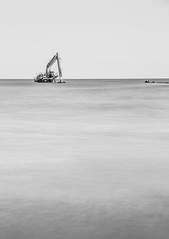 stranded (markhortonphotography) Tags: stranded longexposure excavator beach digger monochrome thatmacroguy rocks westsussex lancing bw le blackandwhite coast markhortonphotography sea lee bigstopper