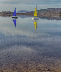 calm waters (judmac1) Tags: calm water lochinsh highlands scotland boats sail loch cairngormnationalpark blue yellow reflection ngc