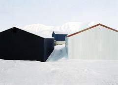Longyear City (Catherine Lemblé) Tags: longyearbyen arctic north norway spitsbergen svalbard snow mountains analog film 120mm mediumformat mamiya645 kodakportra houses industrial