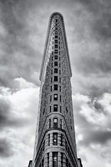 Flatiron (DHaug) Tags: flatiron blackandwhite manhattan fifthavenue broadway east22ndstreet 23rdstreet lookingup skyline architecture cloudy skyscraper newyorkcity nyc landmark iconic vertical getty gettyimages