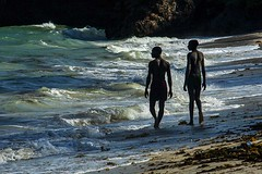 in the surf  2t (photoautomotive) Tags: kenya eastafrica africa water waves warm sea rocks ripples beach people walk whitesand human surf blue watching looking seeing look mombasa fantastic hot canon 5d classic 35350l