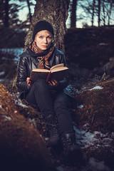 Paula #1 (trm42) Tags: musta metsä musicians blueyes sony rocker kevät 55mm strobist godox leatherjacket forest waltari finnishgirl sonya7ii book muusikko woods reading wearingblack