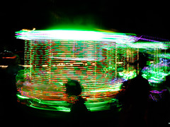 Green carousel (A. Yousuf Kurniawan) Tags: festival nightphotography streetphotography streetlife streetphoto fair silhoutte colourstreetphotography colourstreet abstract green greenlight lamp night carousel motion blur lowspeed light contrast twilight