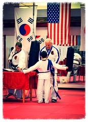 Putting on the new belt (jalyns76) Tags: evan mobile belt nikon purple martial alabama arts taekwondo inner karate strength cermony hoadley
