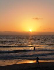 La Jolla Sunset (Trish P. - K1000 Gal) Tags: california sunset reflection water silhouette lajolla pacificocean swimmers