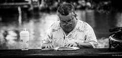 2014 - Ft. Lauderdale -  Dunkin Donuts Reader (Ted's photos - For Me & You) Tags: portrait bw male cup face reading glasses book blackwhite hands reader florida bokeh watch fortlauderdale specs wristwatch helmut ftlauderdale dunkindonuts onecup tedsphotos natgeofacesoftheworld