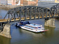 (Shane Henderson) Tags: old bridge blue trees windows winter red white black water sign architecture river logo t boat downtown pittsburgh ship shadows steel branches bricks traintracks rusty stained cables wires worn weathered tugboat empress railroadbridge distressed beams housebuilding supports pnc towboat monongahelariver gatewayclipper gatewayclipperfleet panhandlebridge bridgepiers pncfirstsidecenter fortpittcommons