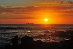 Praia da Luz Beach, Foz, Porto. (sssssoc) Tags: sunset sea sky portugal clouds seaside rocks horizon porto containership shipping foz riodouro nikond3000